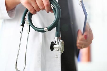 Female doctor hand hold phonendoscope in medical hospital resuscitation background