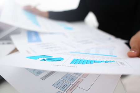 businesswoman study documents in office closeup paperwork concept