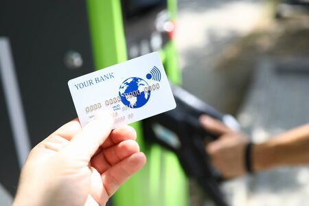 Male hand hold white plastic credit card Stock Photo