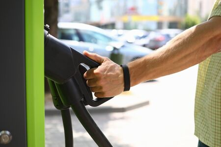 Male hand hold an electric charge