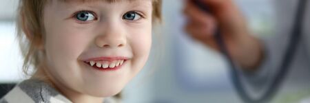 Smiling cute little patient interacting with female doctor Reklamní fotografie