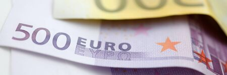 Paper euro 500 and 200 cash lie on the table