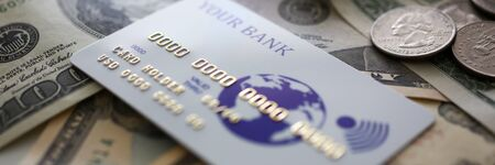 Banking plastic card lying on big amount of US money