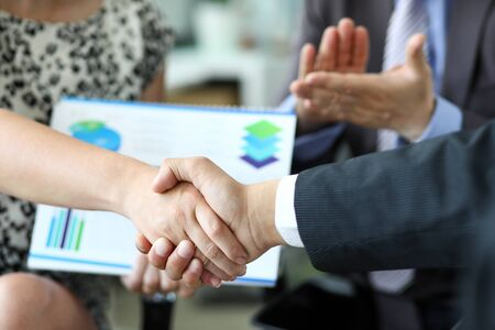 Biz shaking hands of partners