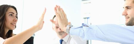 Portrait of smart businesspeople reaching arms performing special friendly gesture to show happy attitude to work and collective. Biz meeting concept. Blurred background 스톡 콘텐츠