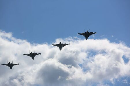 Group of military aircrafts flying in blue sky