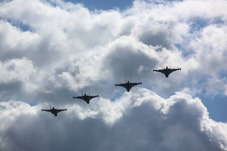 Four destroyers on airshow in white clouds 스톡 콘텐츠