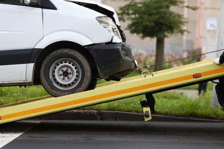 Wrecked car drives into tow truck closeup Standard-Bild