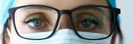 Woman doctor in glasses and medical mask portrait. Stok Fotoğraf