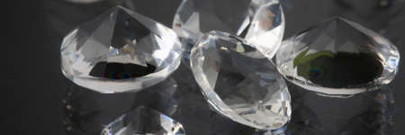 Precious expensive stones lie on black background 版權商用圖片
