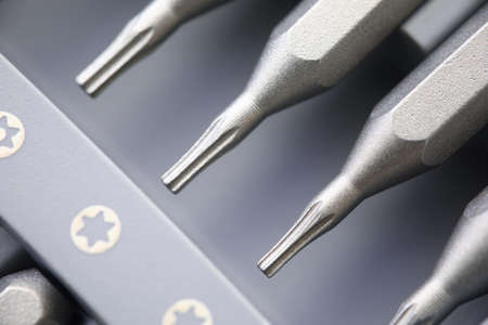 Metal nozzles for screwdriver heads set for work closeup.