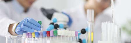Two researchers are conducting experiments in laboratory. Foto de archivo
