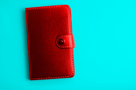 red notepad on a blue background design