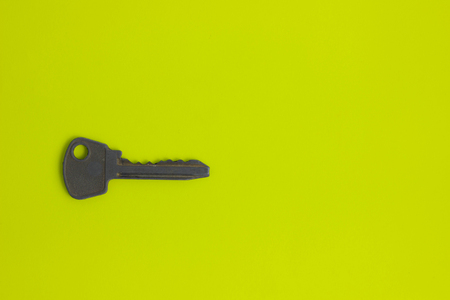 overhead of many different keys in oder on yelow background concept metal Stock Photo