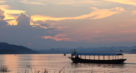 Boat sailing in Mekong River at sunset time