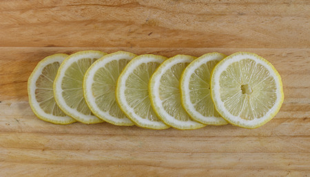 Lemon slices on the  wooden table. Top view. Фото со стока
