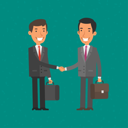 Two businessman shake hands and smile