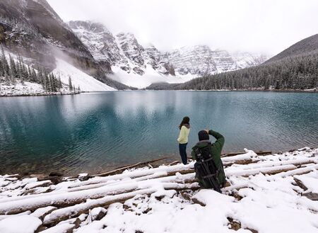 winter escape: Photographer takes picture of female model next to beautiful lake in snow