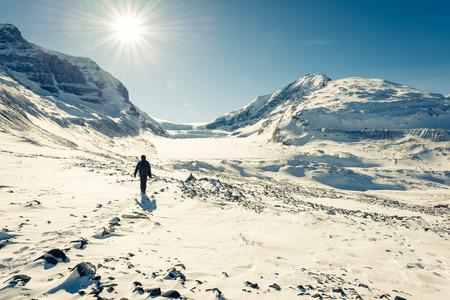 Young man hiking at Athabasca Glacier