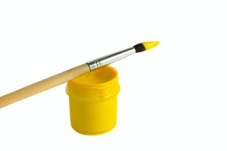 Art paintbrush with yellow paint isolated on white horisontal Stock Photo