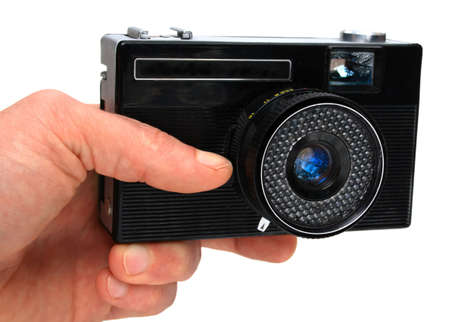 aged camera in an hand isolated on white