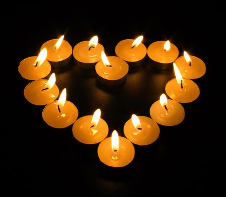 heart from candles in the dark Stock Photo
