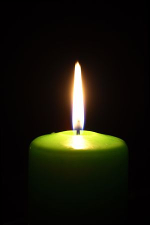 Green candle in the dark