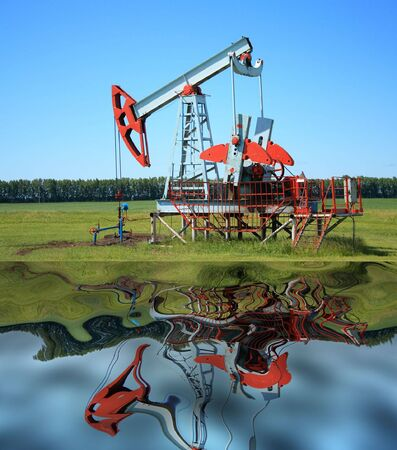 Oil Pump Jack near a water
