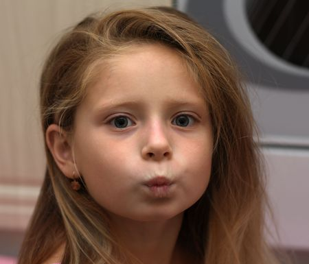 puckering lips: little girl kissing to you Stock Photo