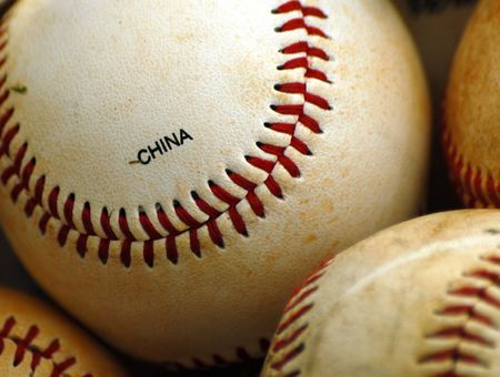 Closeup of dirty baseballs that were made in China photo