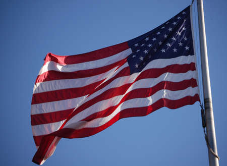 A closeup of an American flag flying in the breeze