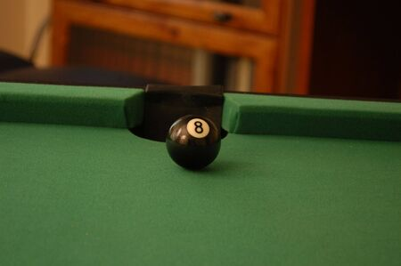 A game of pool with a shot lined up