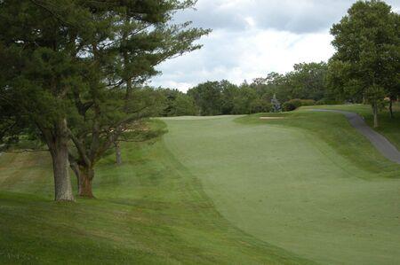 A golf fairway along a rolling course