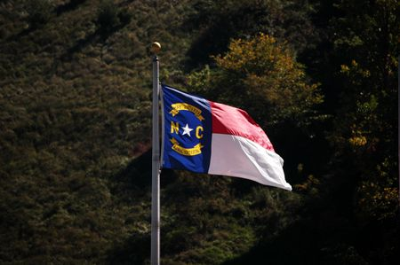 North Carolina flag blowing in the breeze Imagens