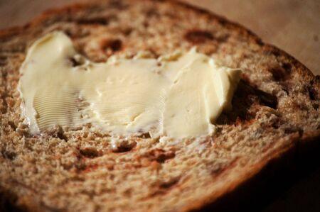 cinnimon: cinnimon bread with fresh butter on it