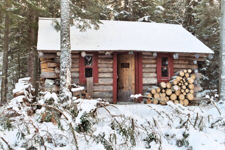 winter: A log cabin in the woods during the winter seaso