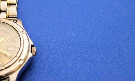 View of a watch up close on a blue background