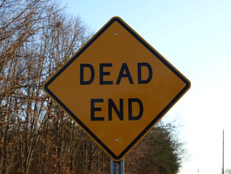 end road: A dead end road sign shown up close