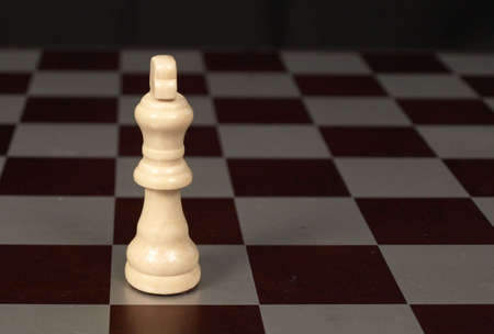 White king on a chessboard shown up close