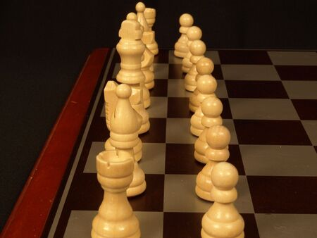 Row of white chess pieces ready for the game