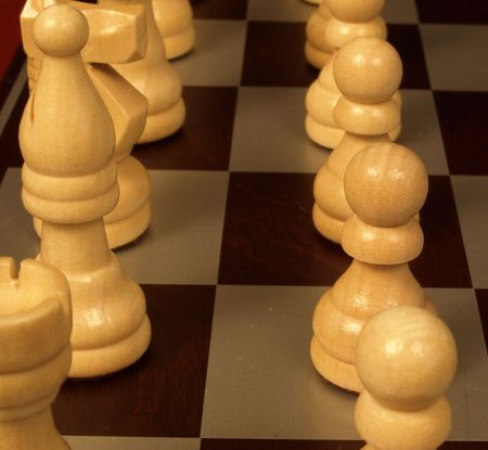 Upclose view of the chess pieces on a board