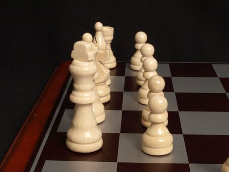 White pieces on the board at the start of a match