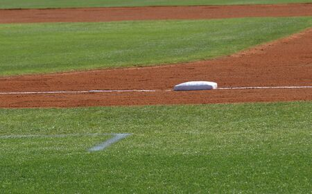 baseball stadium: First base view shown closeup on a baseball diamond