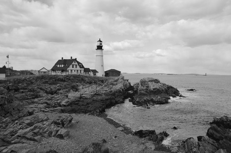 Famous portland head light off the coast of maine shown in black and white. photo