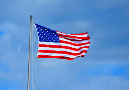 American flag blowing in the breeze on a summer day Stock Photo - 13067312
