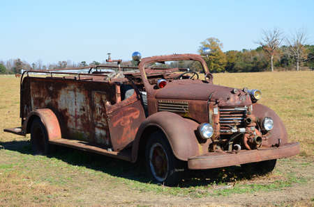 fade away: Old rusted firetruck in the field left to fade away