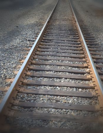 off track: Railroad track heading off into the distance. Stock Photo