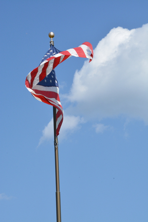 An american flag blowing in the breeze.