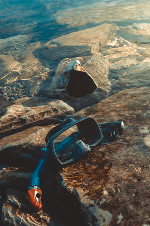 freediving: Mask For Freeiving And Snorkel Lie On The Beach, On The Rocks. Tourism And Travel Concept