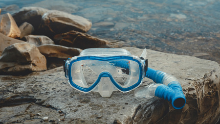 Mask For Freediver And Snorkel Lie On The Beach, On The Rocks. Tourism And Travel Concept Stock Photo